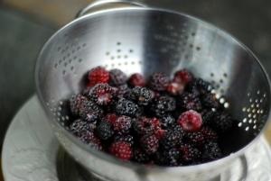 black raspberries in colander