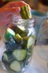 cucumbers in canning jar