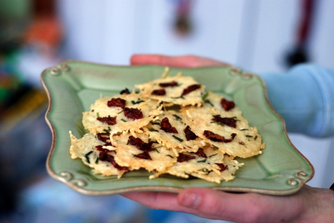 parmesan crisps on plate both hands